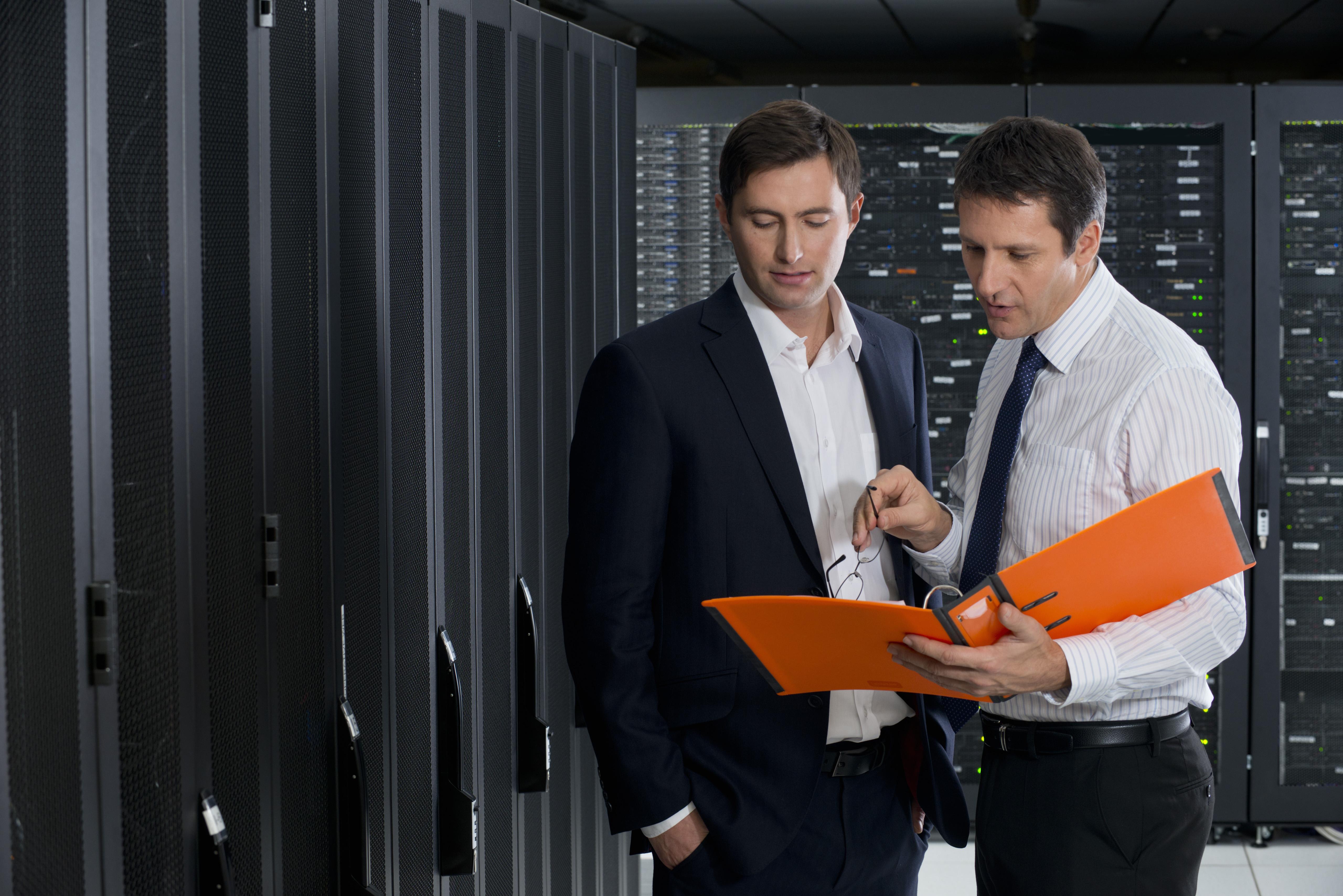 Businessmen in iomart data centre