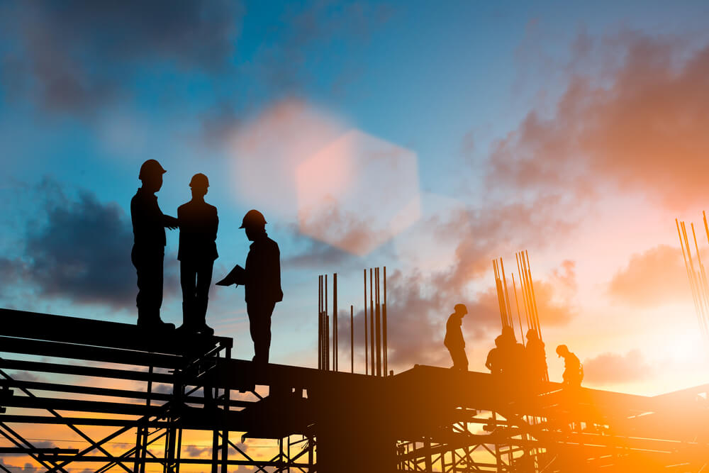 Project managers on building site - SaaS case study CEMAR - iomart